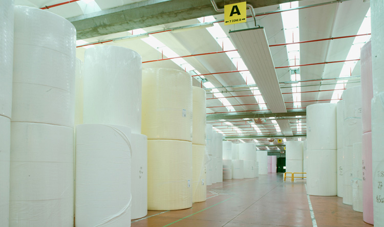 Tissue paper rolled on core in storage room.